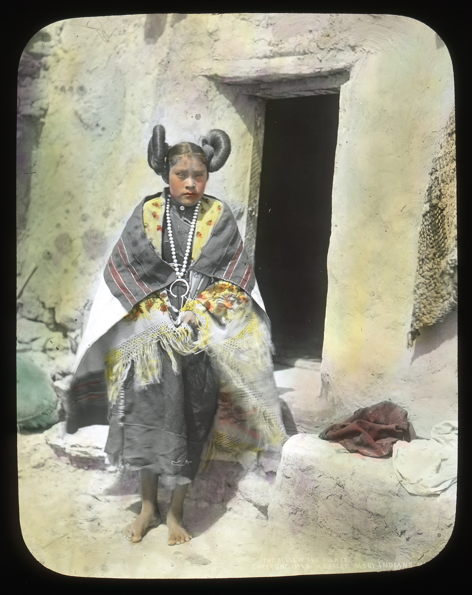 A lantern slide of a Hopi girl in traditional dress.