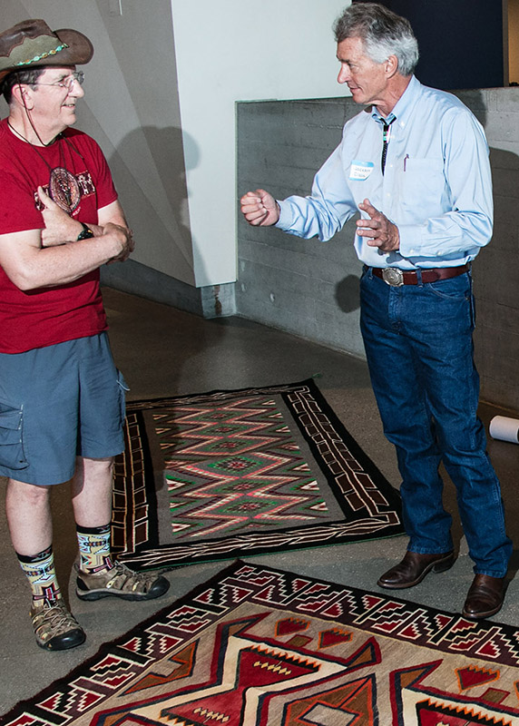 Jackson Clark II talks to a guest about Navajo rug restoration.