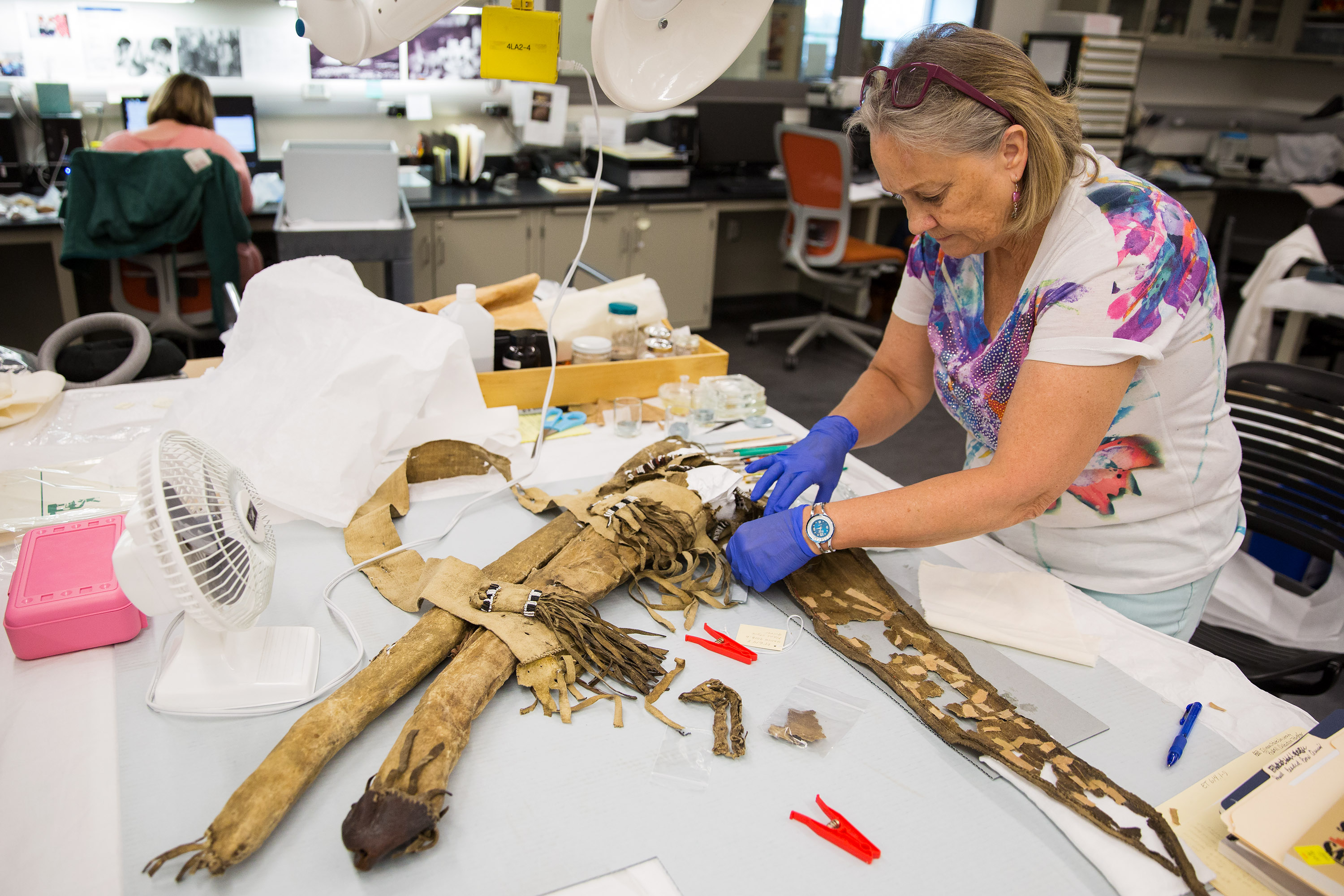 NHMU staff working to restore Otter skin quiver collected by explorer John Wesley Powell on his expeditions along the Colorado River.