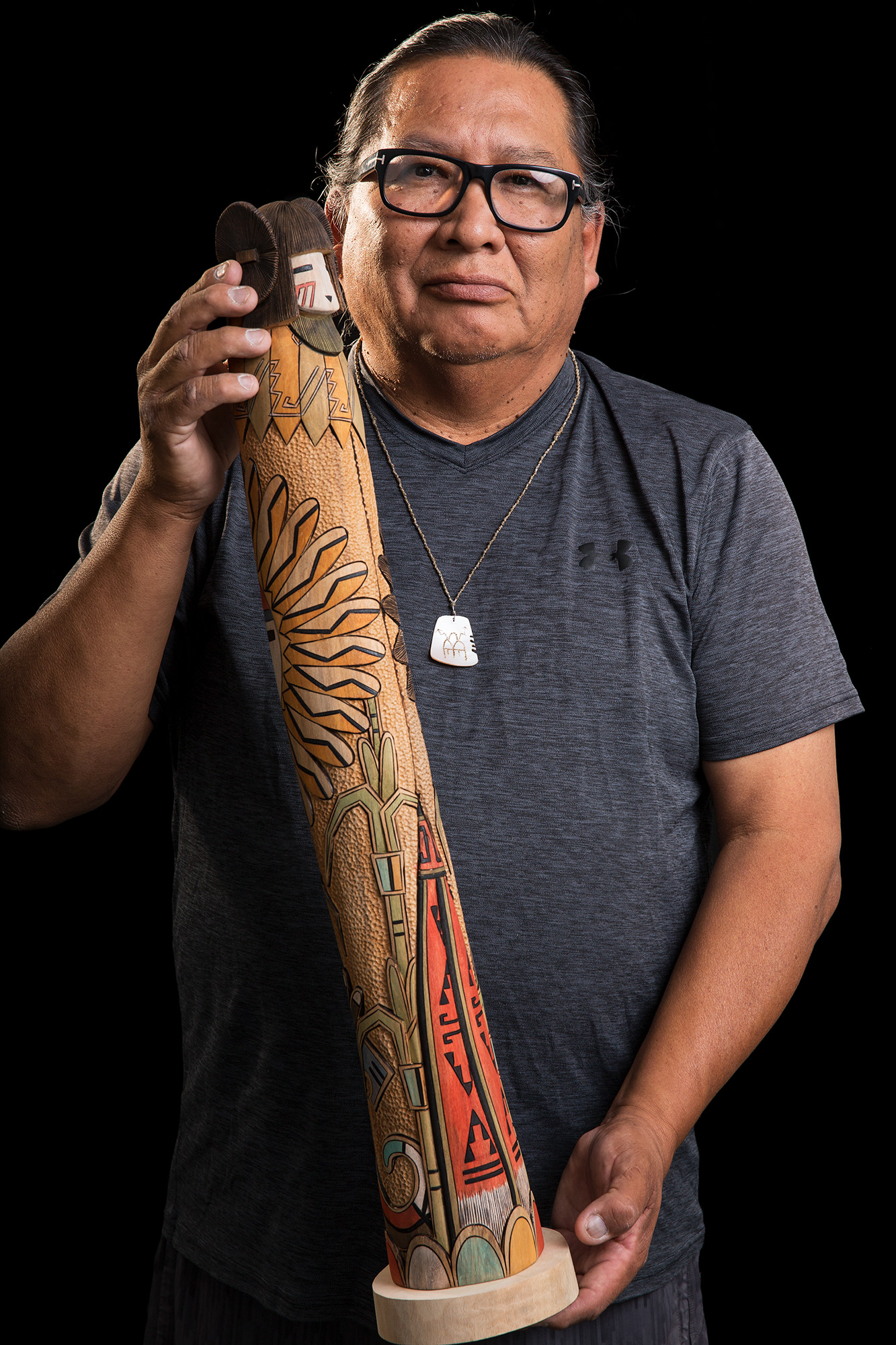 Portrait of Kevin H. Quannie holding 2018 best of show corn maiden kachina