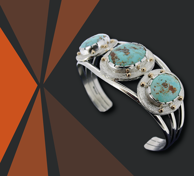 A Native American bracelet of silver and turquoise.