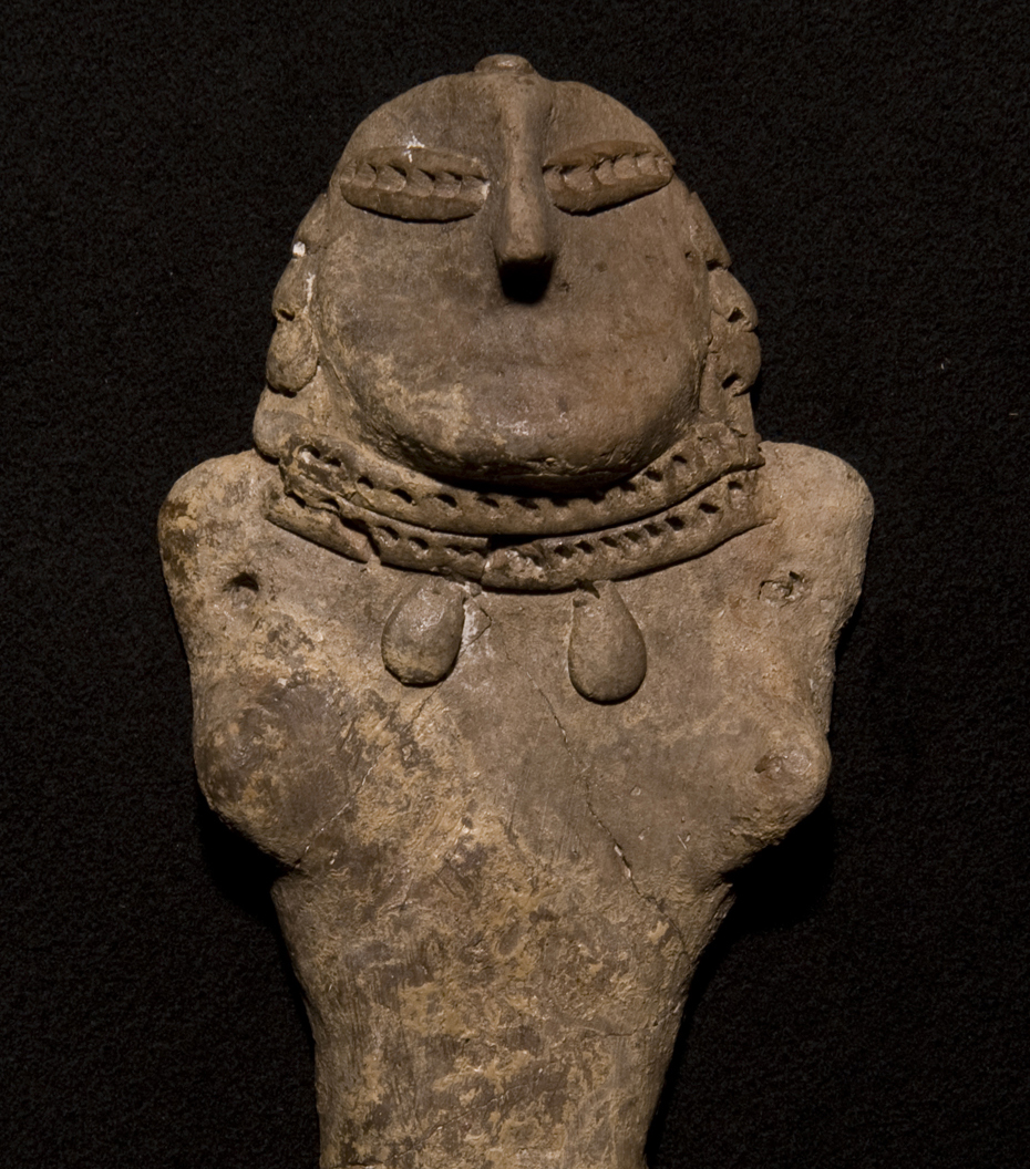 A carved stone figure.