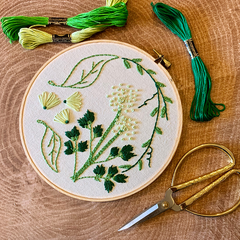 An embroidery of green plants.