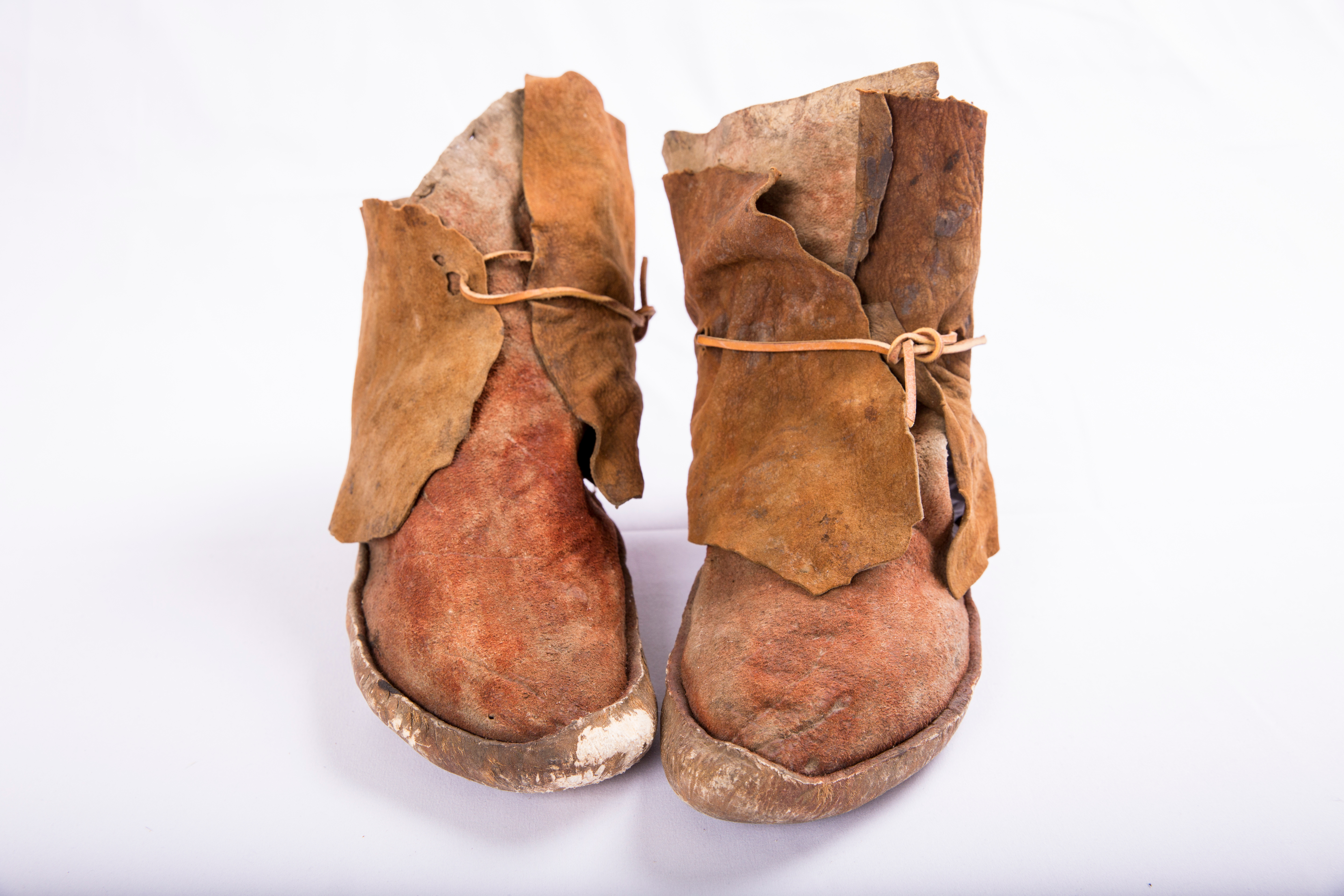 Scuffed pair of moccasins with hard sole, possibly Navajo or Hopi