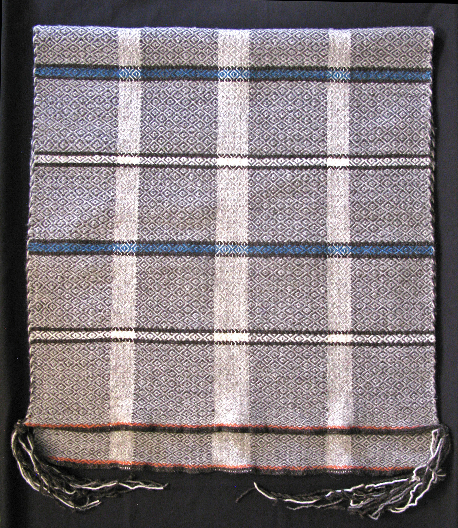 Handwoven Navajo Curro Wool scarf in thin plaid pattern