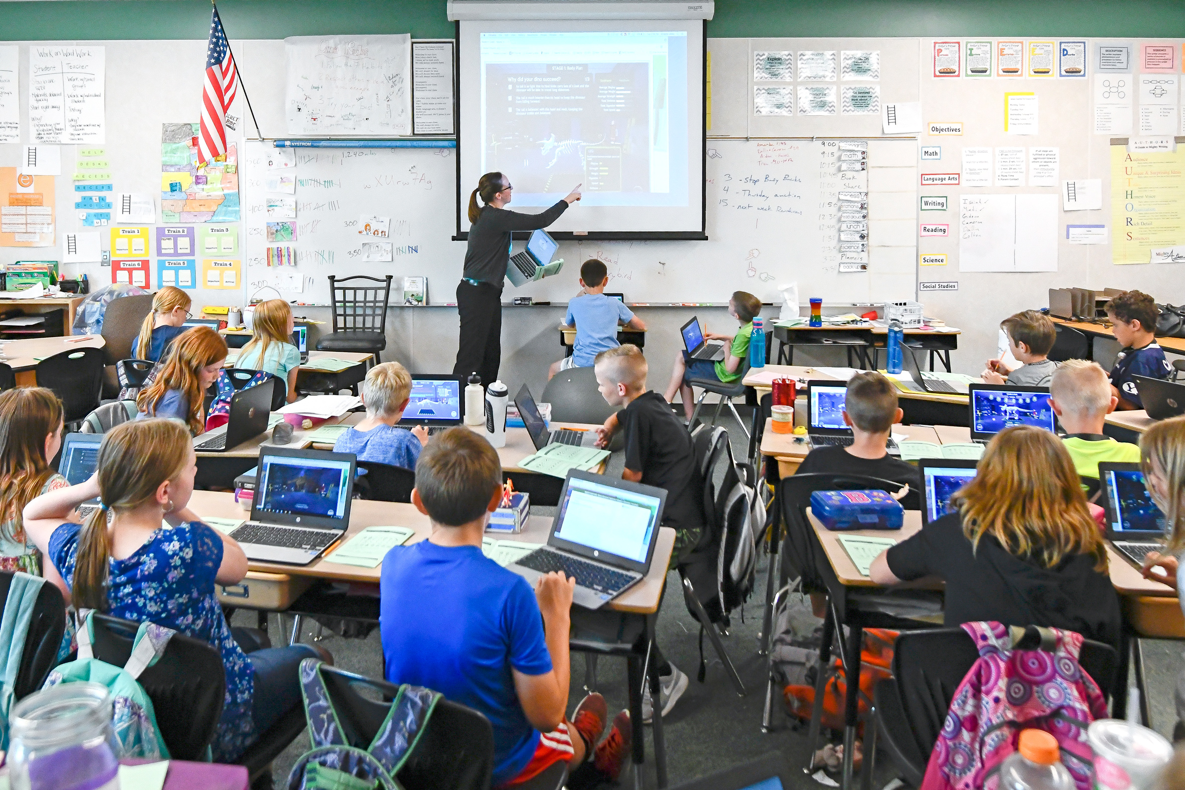 Teacher and students discuss Research Quest in classroom.