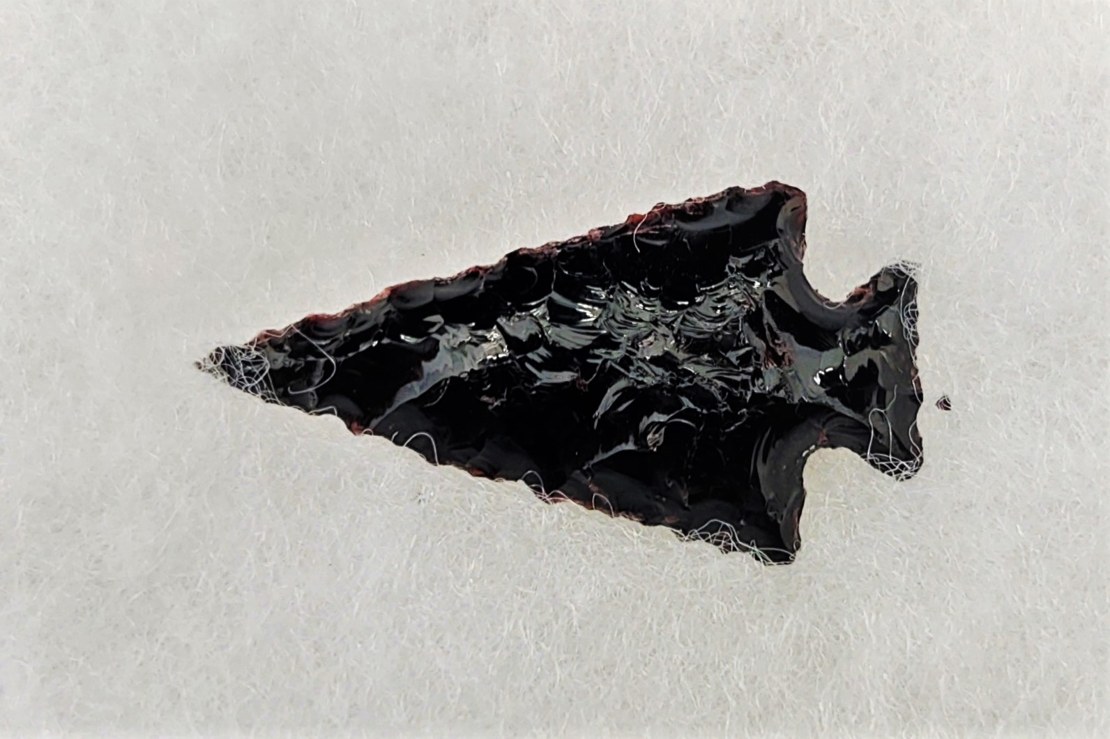 A black obsidian projectile point