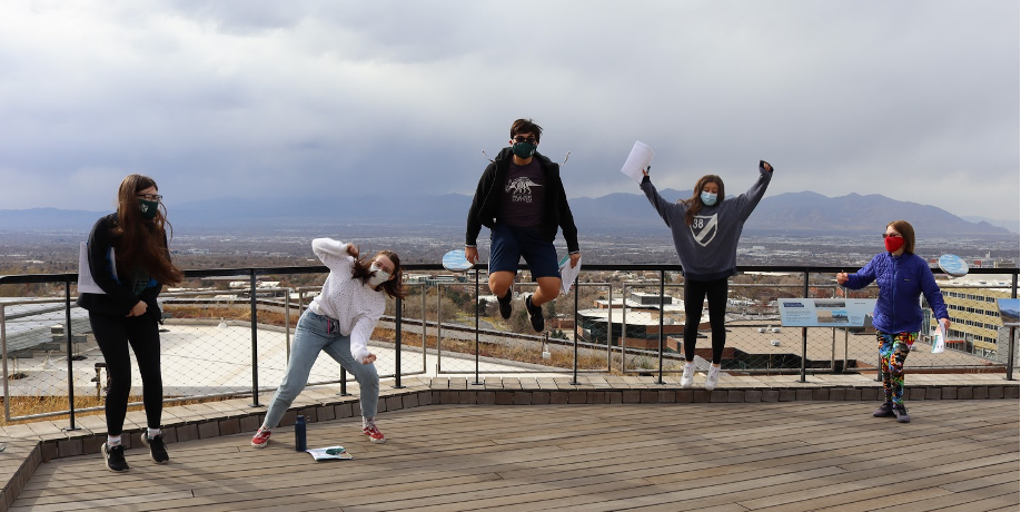 Teens jumping on the terrace