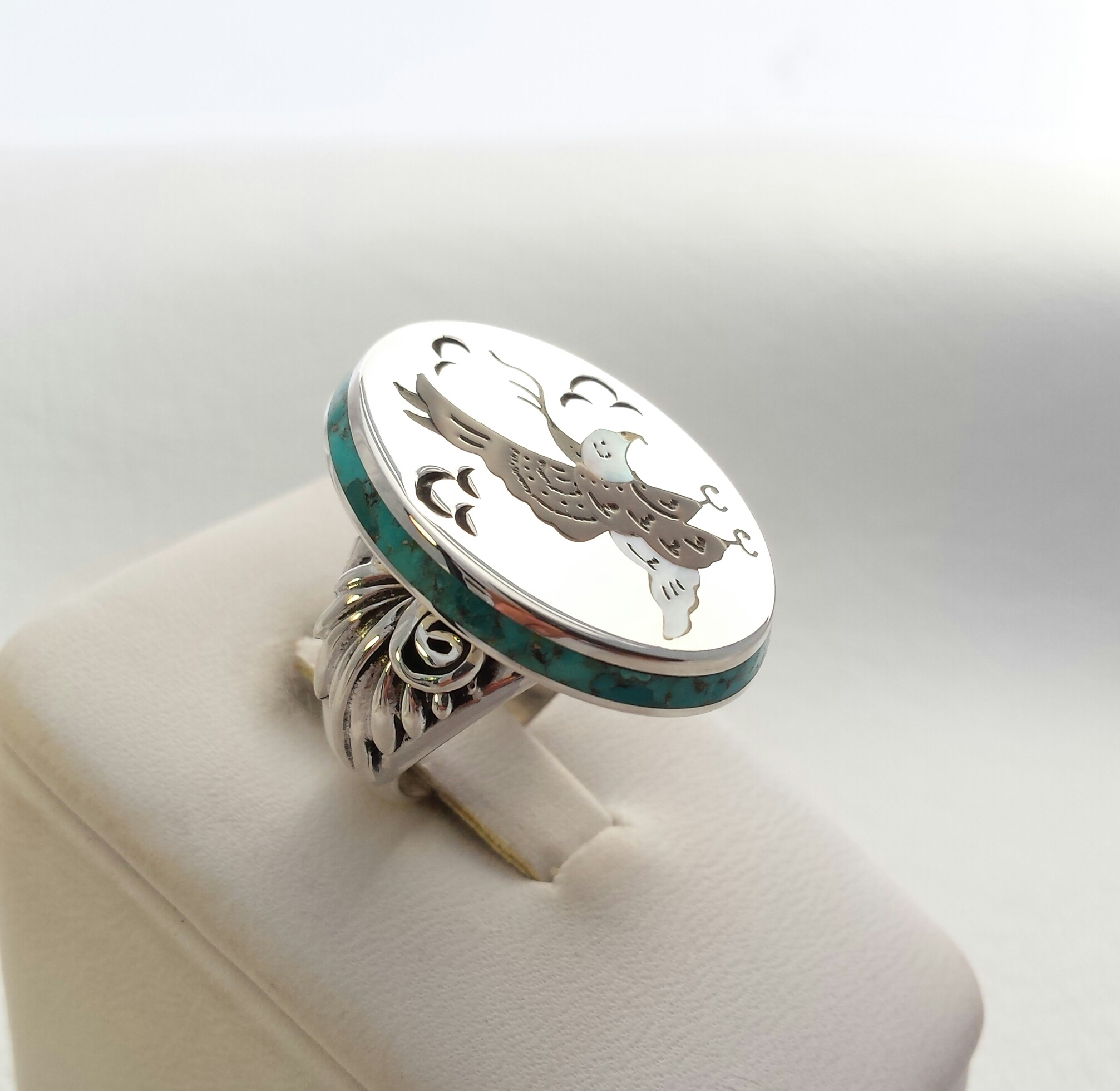 Sterling silver ring inlaid with turquoise, Mother of Pearl and Black Penshell. Eagle inlaid on face