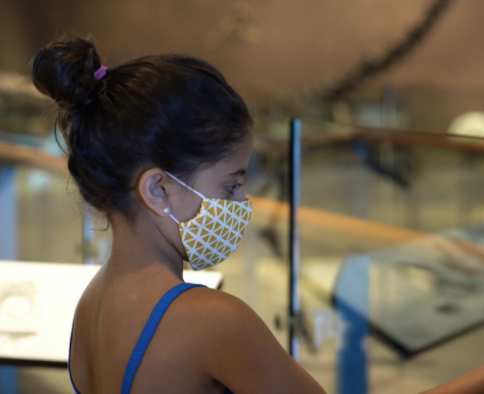 photo of girl wearing mask at museum