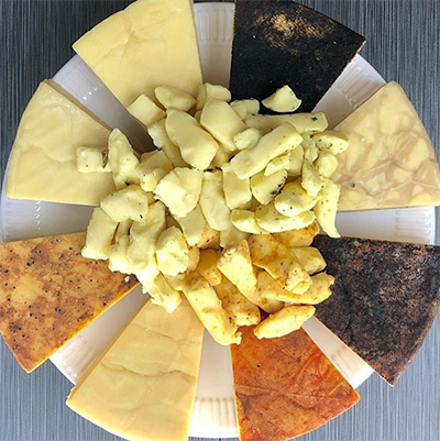 A selection of cheeses displayed in a circle.