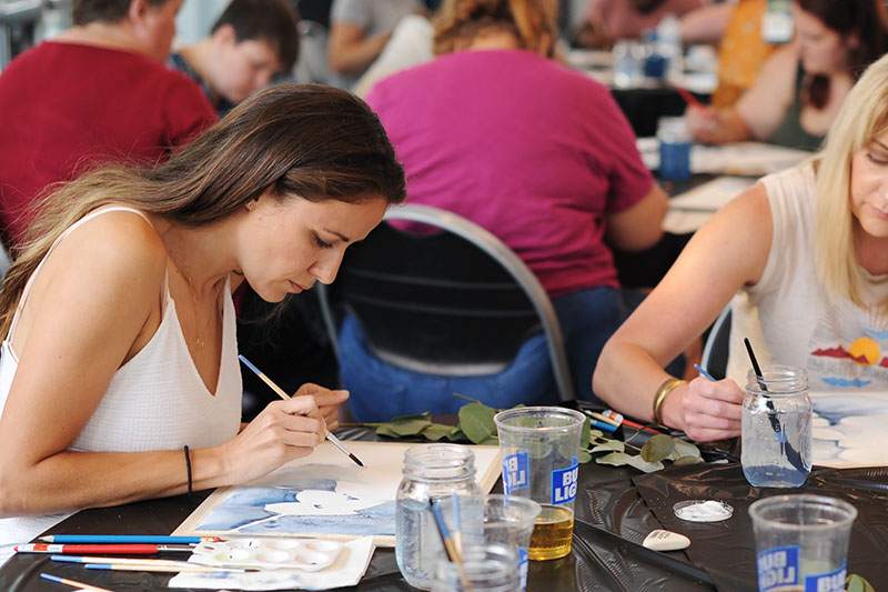 Participants take part in a painting workshop.