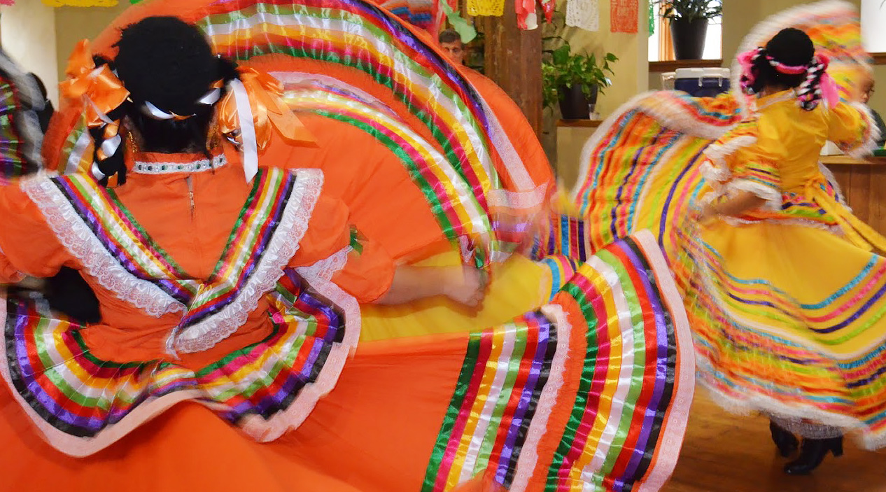 Dancers in colorful dresses.