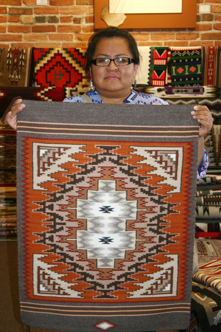 Navajo weaver LaVera Ambrose with her work.