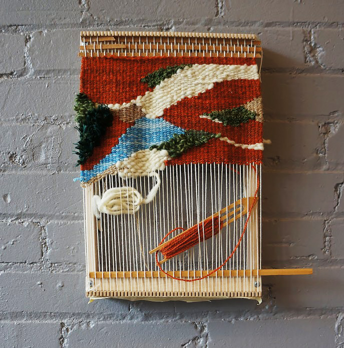 A woven wall hanging.