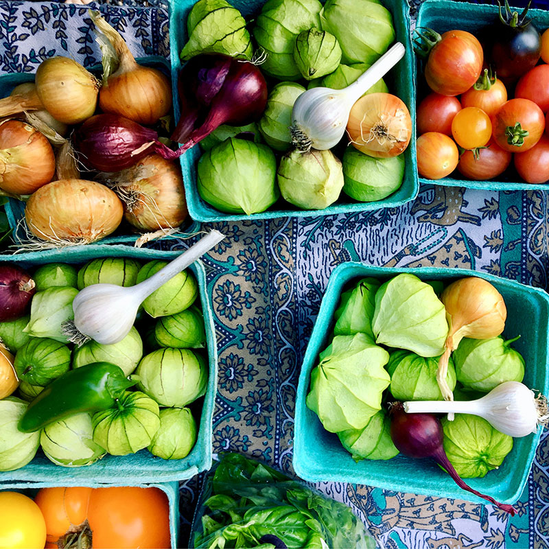 Tomatillos, tomatoes, and onions.