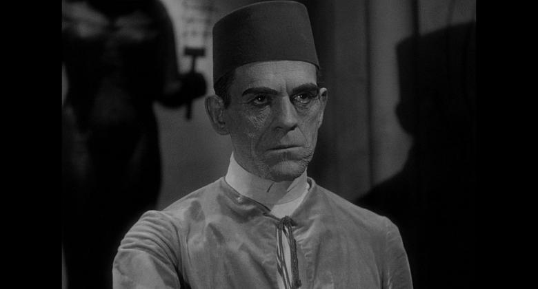 A close-up of actor Boris Karloff in a fez, playing the reincarnated mummy from the Universal film.