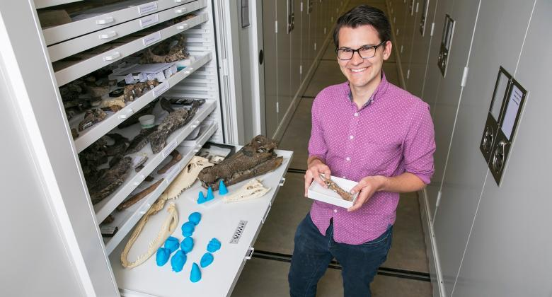 University of Utah graduate student Keegan Melstrom and some of the fossil croc material his studied.