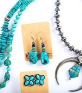 Turquoise jewelry photographed against a white backdrop.