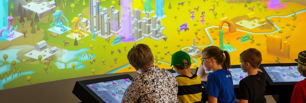 Children play the Utah Climate Challenge at NHMU