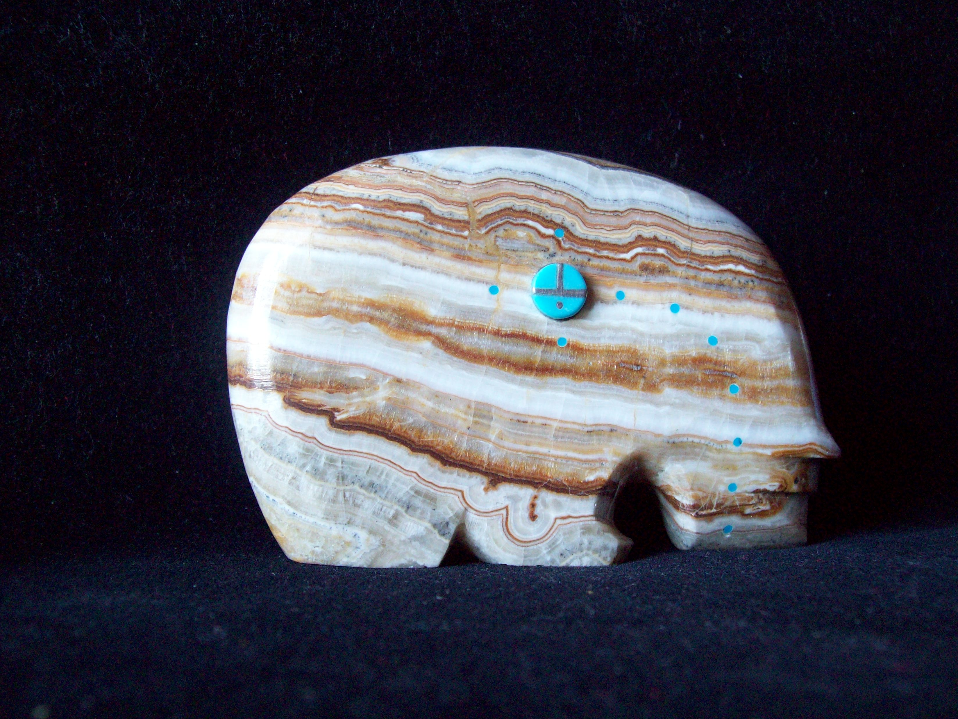 Handcarved varigated Vista Grande Onyx stone embellished with small spots of inlaid turquoise